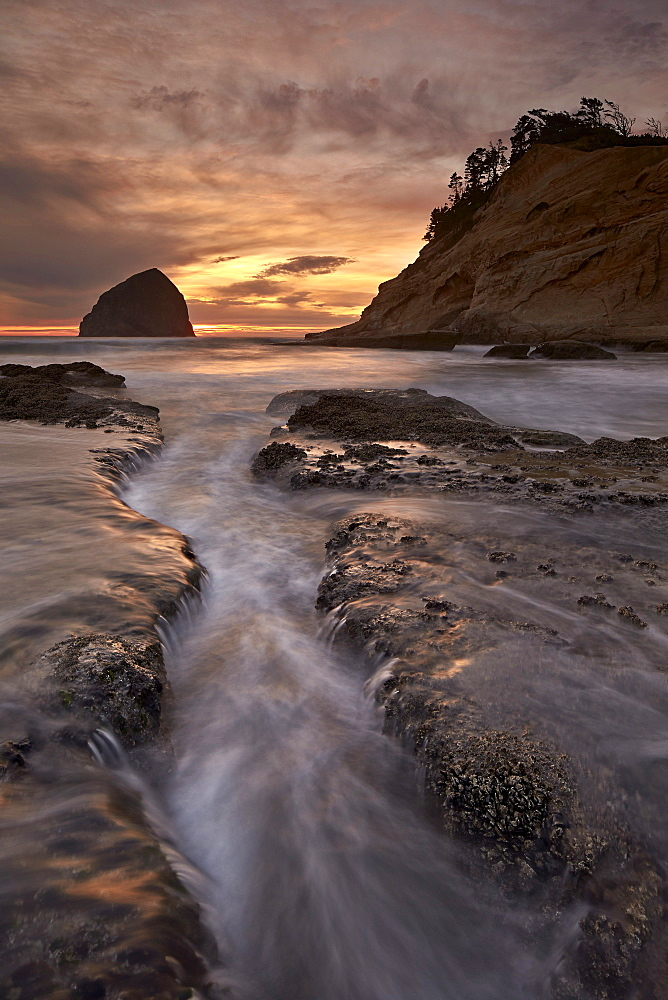 Haystack Rock at sunset, Pacific City, Oregon, United States of America, North America