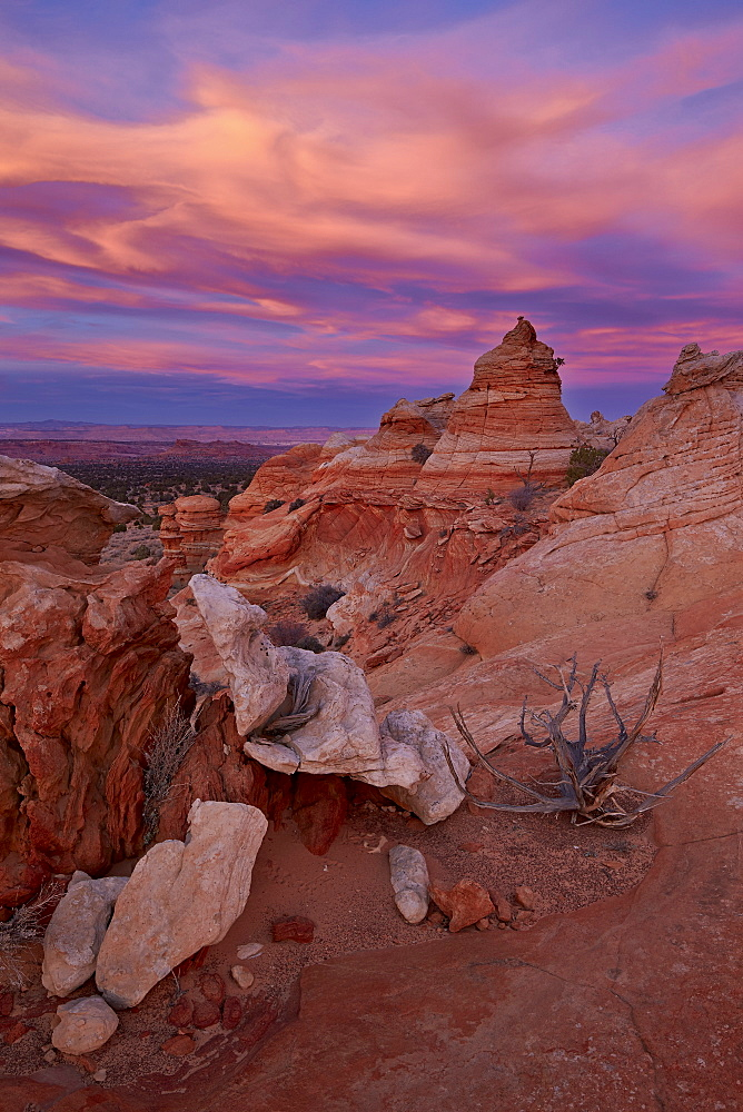 Orange clouds at sunset over sandstone cones, Coyote Buttes Wilderness, Vermilion Cliffs National Monument, Arizona, United States of America, North America