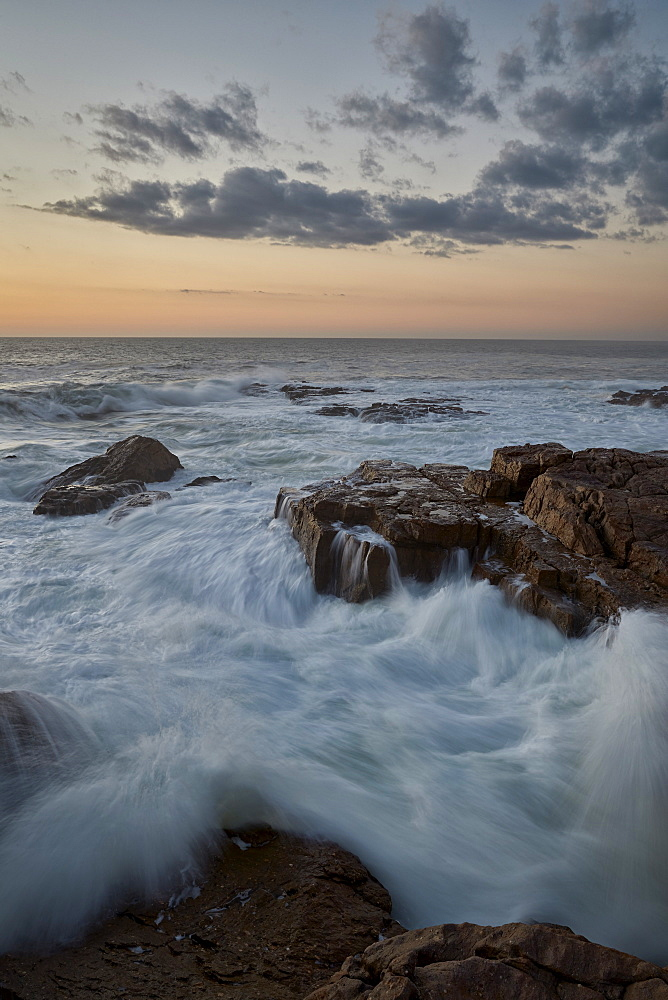 Surf along the rocky coast at sunset, Elands Bay, South Africa