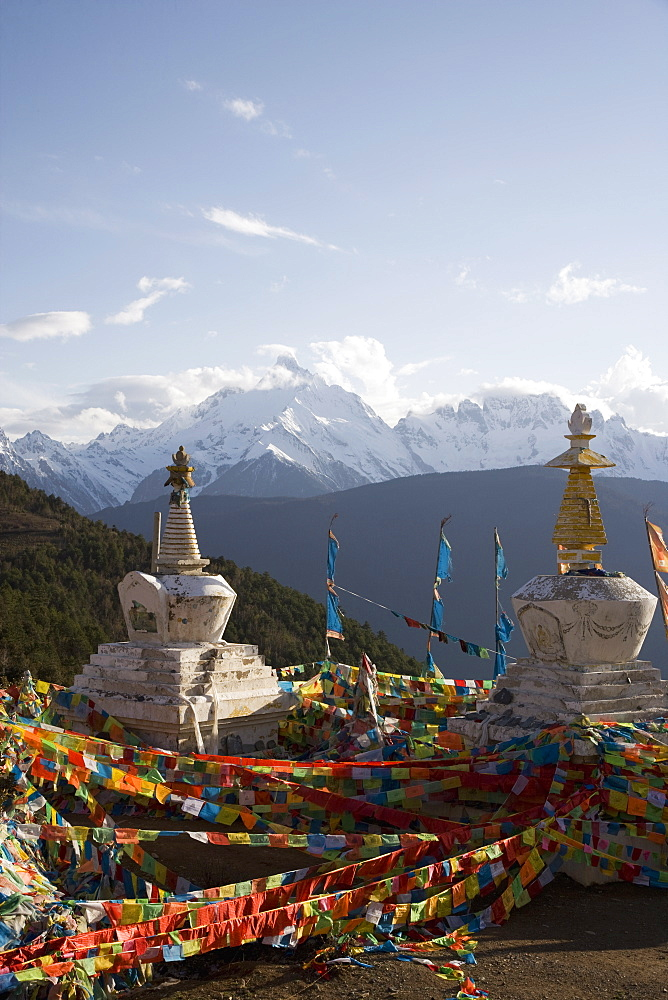 Buddhist stupas on way to Deqin, on the Tibetan Border, with the Meili Snow Mountain peak in the background, Dequin, Shangri-La region, Yunnan Province, China, Asia