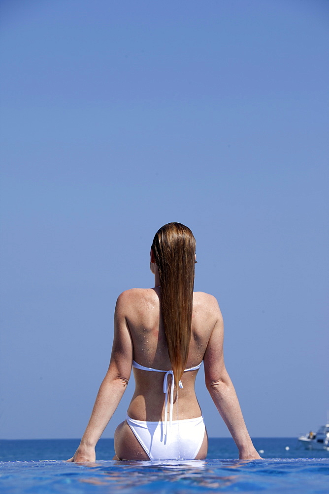 Woman in infinity pool, Kuramathi Island, Ari Atoll, Maldives, Indian Ocean, Asia