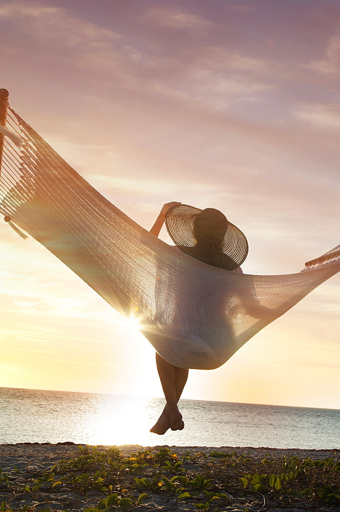 Woman on a hammock on the beach, Florida, United States of America, North America