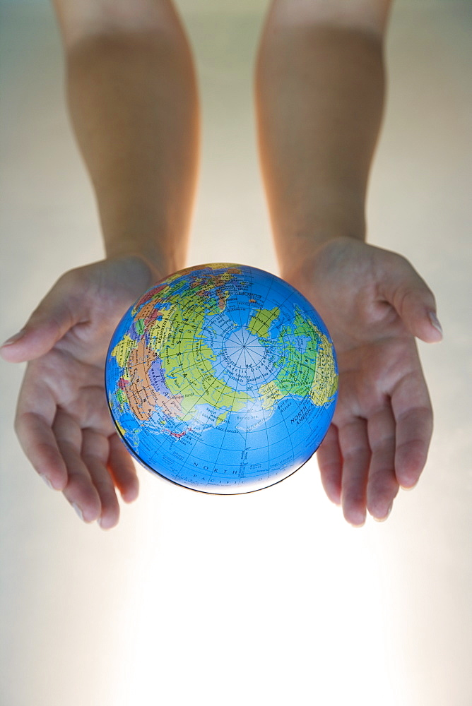 Woman's hands with world globe
