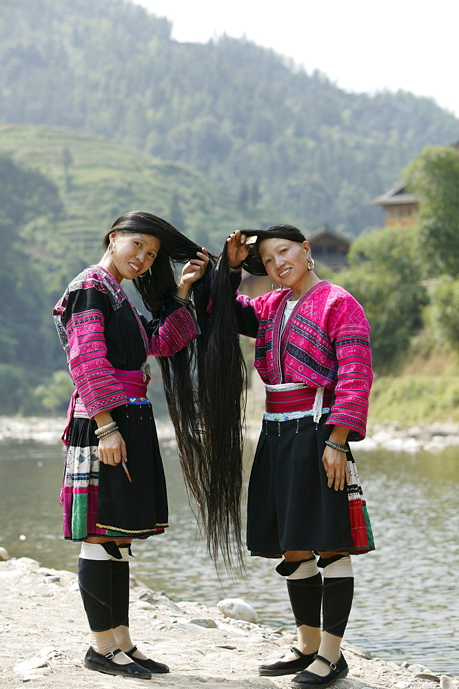 Young women of Yao Minority (Long hair) tribe, Huanglo Yao village, Longsheng terraced ricefields, Guangxi Province, Guilin, China, Asia