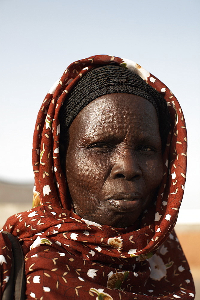 South Sudanese woman bearing tribal scarification markings, Khartoum, Sudan, Africa