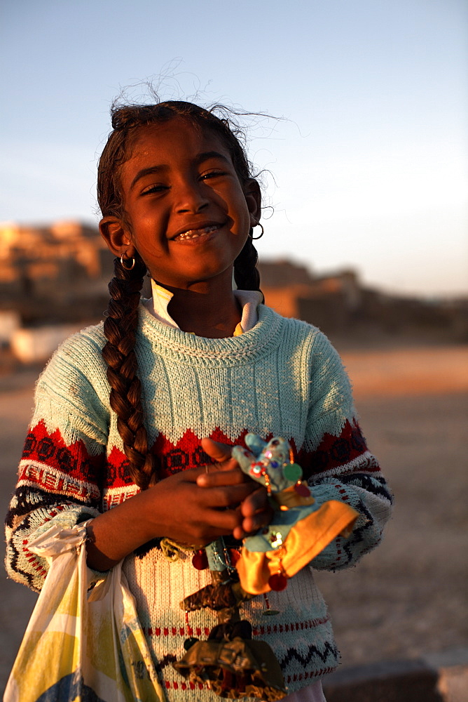 A local girl selling souvenirs on Luxor's West Bank, Egypt, North Africa, Africa