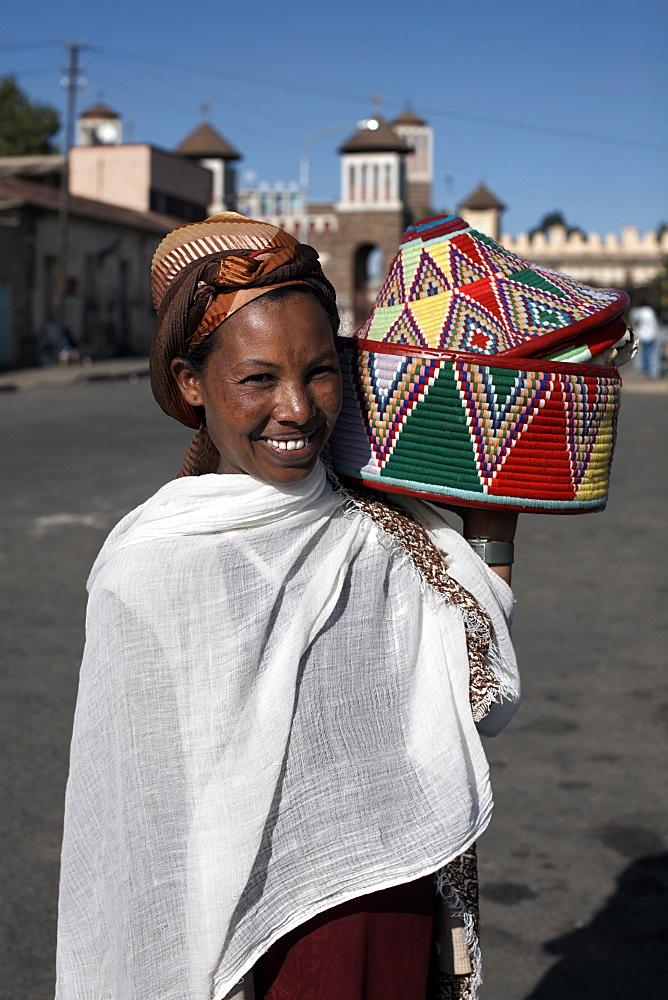 An Eritrean woman with traditional lunch box, Asmara, Eritrea, Africa
