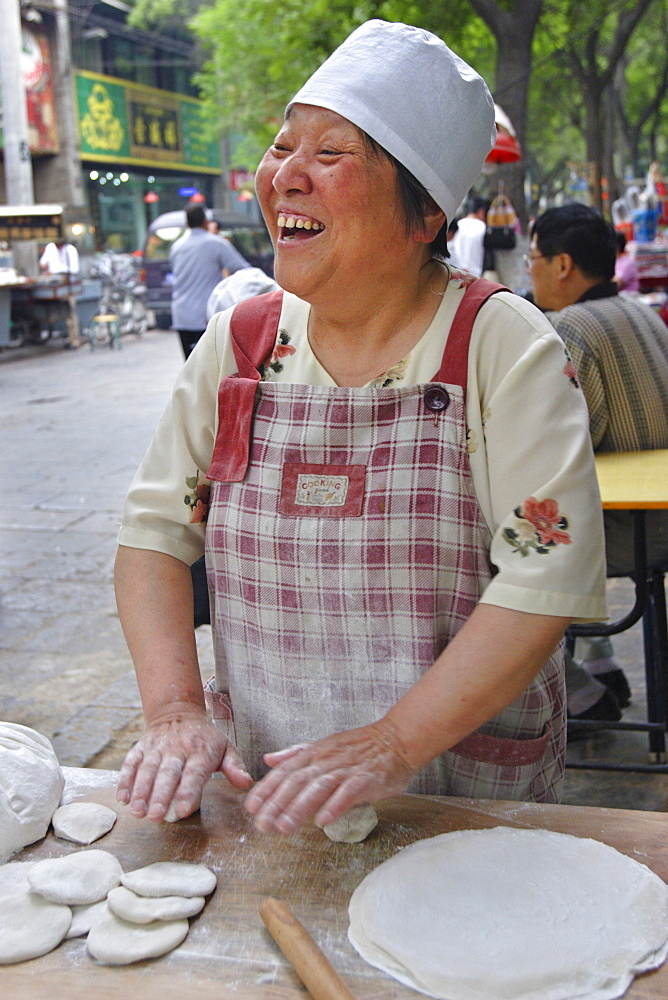 Woman making bread in the Muslim quarter of Xi'an, China, Asia