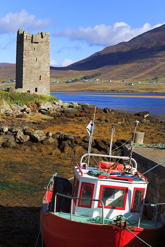 Kildownet Castle and fishing boat on Achill Island, County Mayo, Connaught (Connacht), Republic of Ireland, Europe