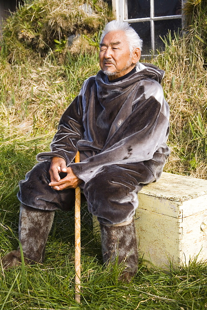 Native man wearing seal skin clothing, Museum in Nanortalik Port, Island of Qoornoq, Province of Kitaa, Southern Greenland, Kingdom of Denmark, Polar Regions
