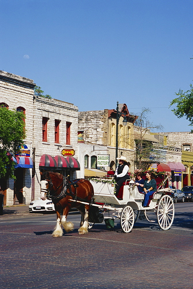 Horse and carriage on 6th Street, Austin, Texas, United States of America, North America