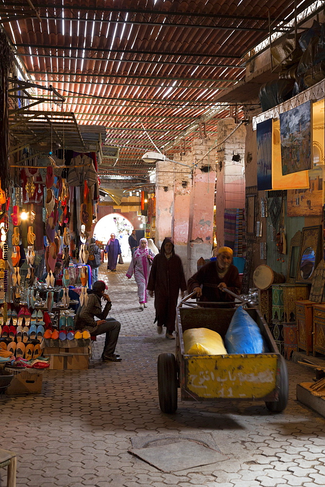 People in traditional dress walking through the souks, Marrakech, Morocco, North Africa, Africa