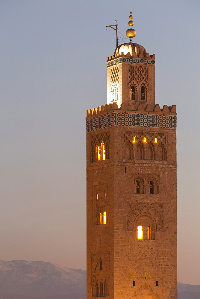 The Minaret of the Koutoubia Mosque, UNESCO World Heritage Site, at dusk with the Atlas mountains beyond, Marrakech, Morocco, North Africa, Africa