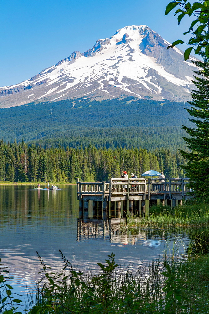 Fishing on Trillium Lake with Mount Hood, part of the Cascade Range, reflected in the still waters, Oregon, United States of America, North America