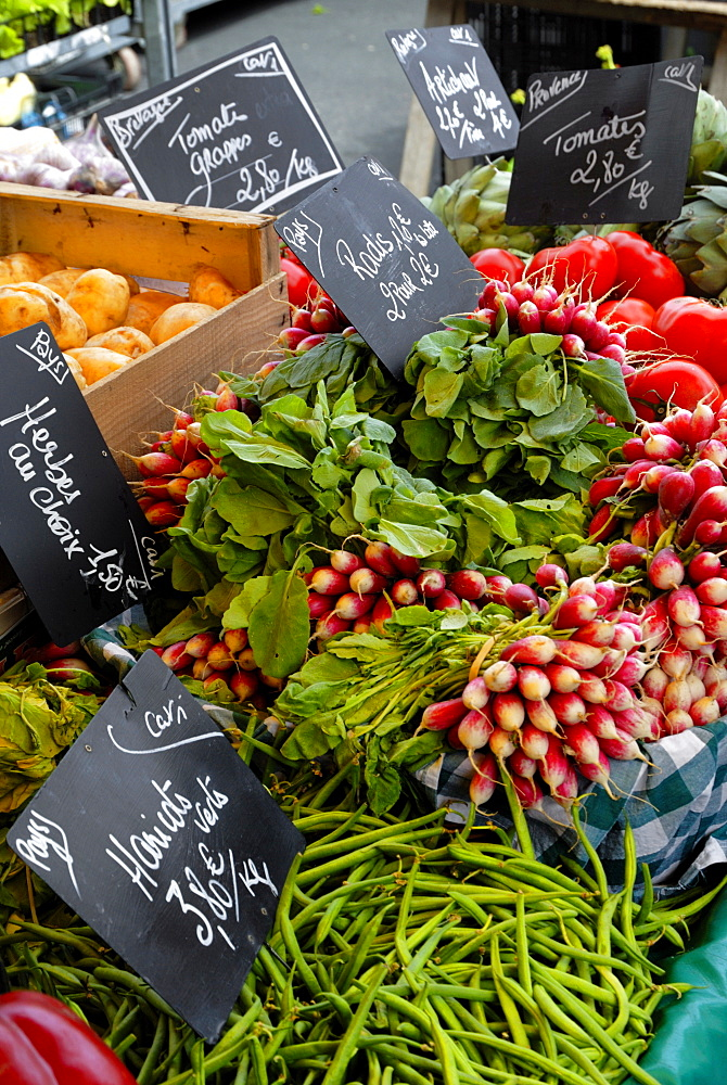 Salad and vegatables on a market stall, France, Europe