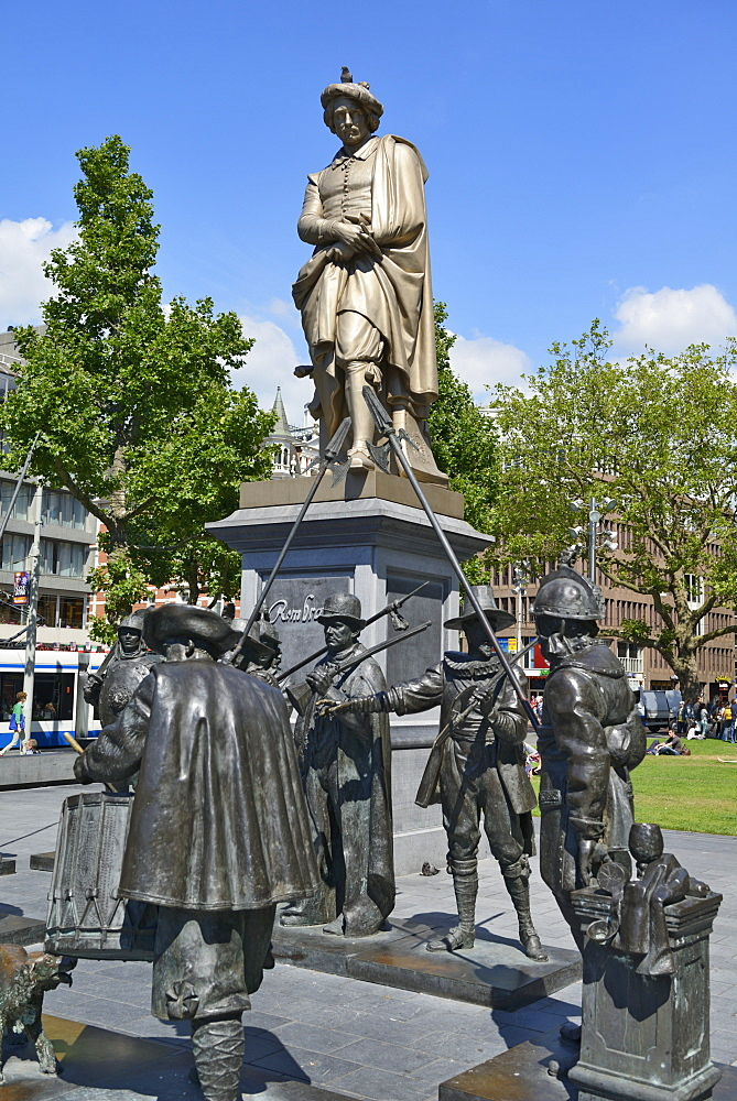 Statue of Rembrandt surrounded by figures from his painting The Night Watch, Rembrandtplein, Amsterdam, North Holland, Netherlands, Europe