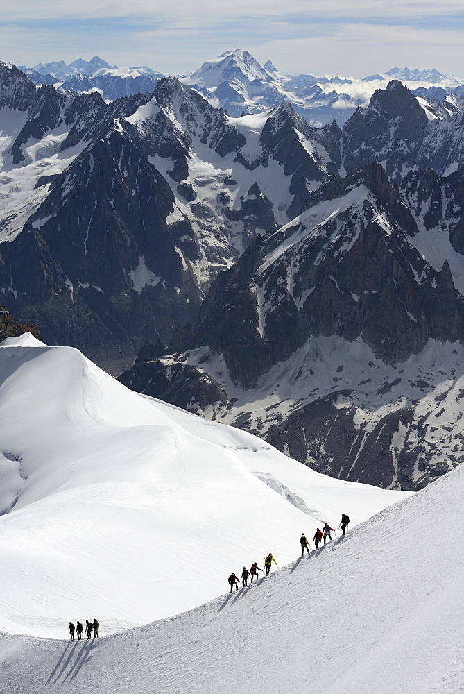 Mountaineers and climbers hiking on a snowy ridge, Aiguille du Midi, Mont Blanc Massif, Chamonix, Haute Savoie, French Alps, France, Europe - 792-793