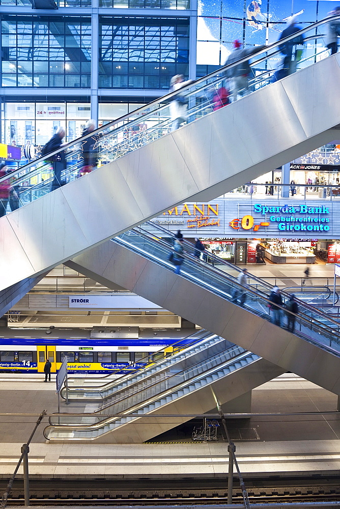 People moving up escalator at new modern main railway station, Berlin, Germany, Europe