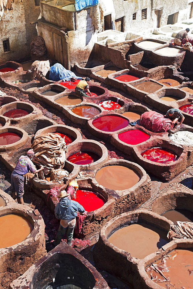 Vats for tanning and dyeing animal hides and skins, Chouwara traditional leather tannery in Old Fez, Fez, Morocco, North Africa, Africa