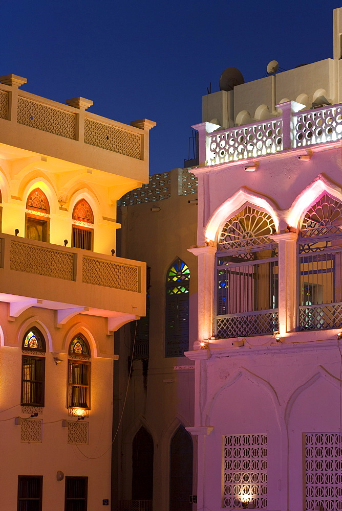 Colourfully illuminated latticed houses along the corniche, Mutrah, Muscat, Oman, Middle East - 794-178