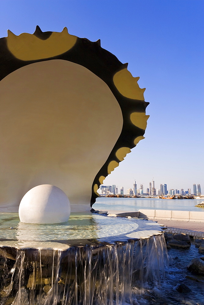 Pearl Momument on the Corniche of Doha Bay with the central business district of the West Bay on the horizon, Doha, Qatar, Middle East