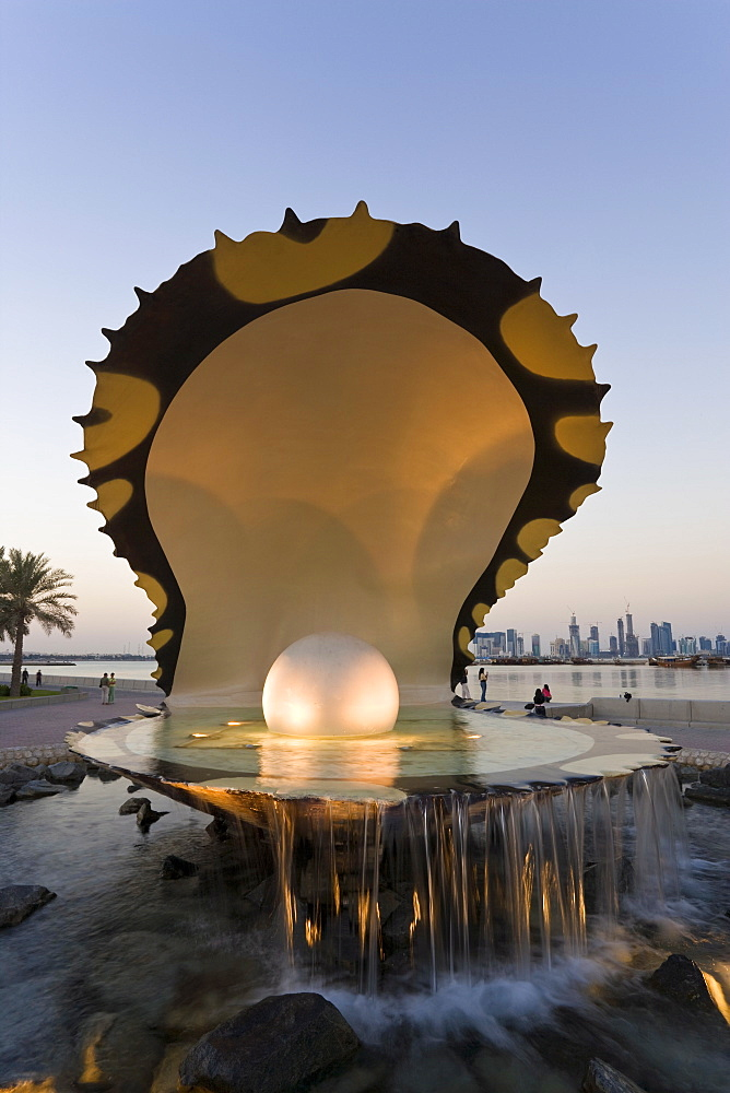 Pearl Monument on the Corniche of Doha Bay with the central business district of the West Bay on the horizon, Doha, Qatar, Middle East