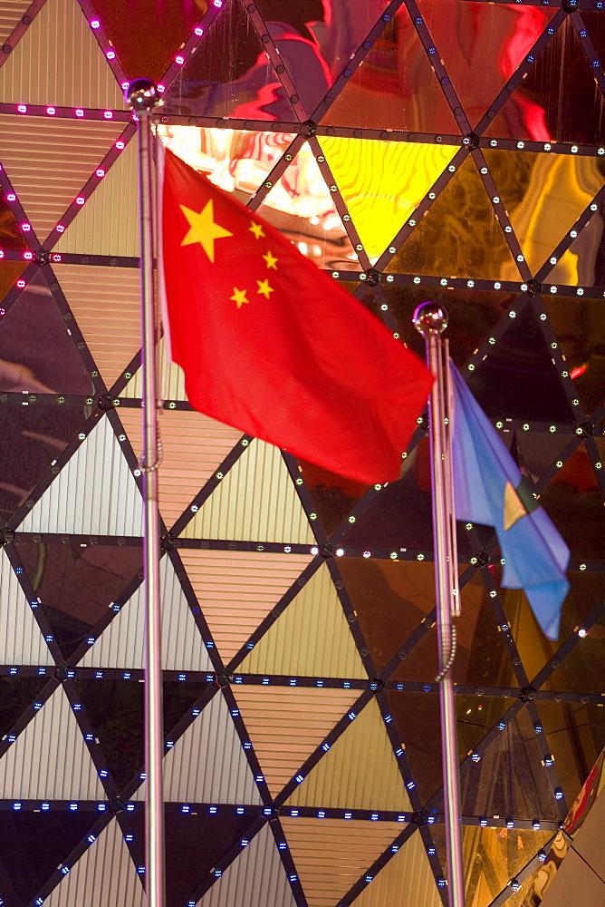 Chinese flag flying outside the Grand Lisboa Casino, Macau, China, Asia