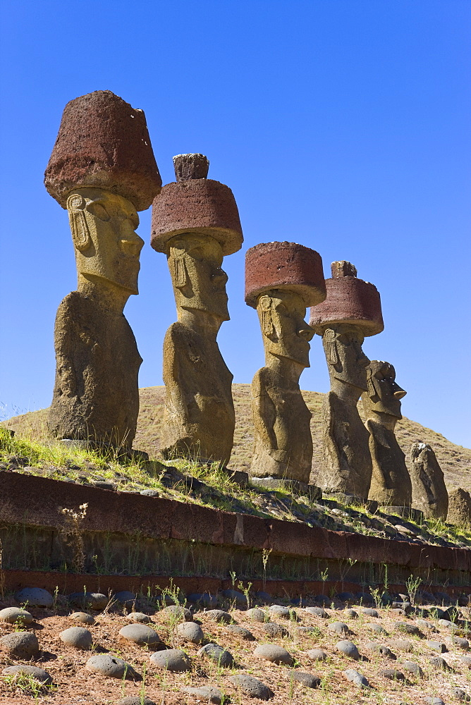 Anakena beach, monolithic giant stone Moai statues of Ahu Nau Nau, four of which have topknots, Rapa Nui (Easter Island), UNESCO World Heritage Site, Chile, South America - 794-420