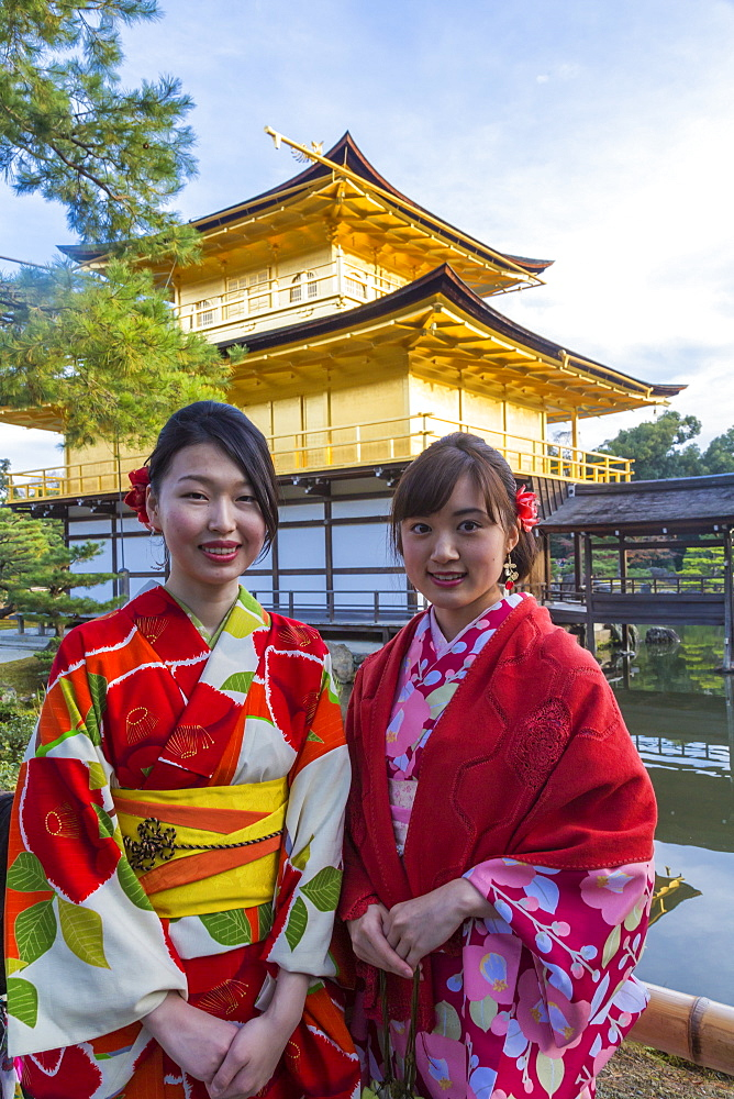 Women in traditional Japanese kimonos in front of the Golden Pavilion temple (Kinkaku-ji) in Kyoto, Japan - 794-4495
