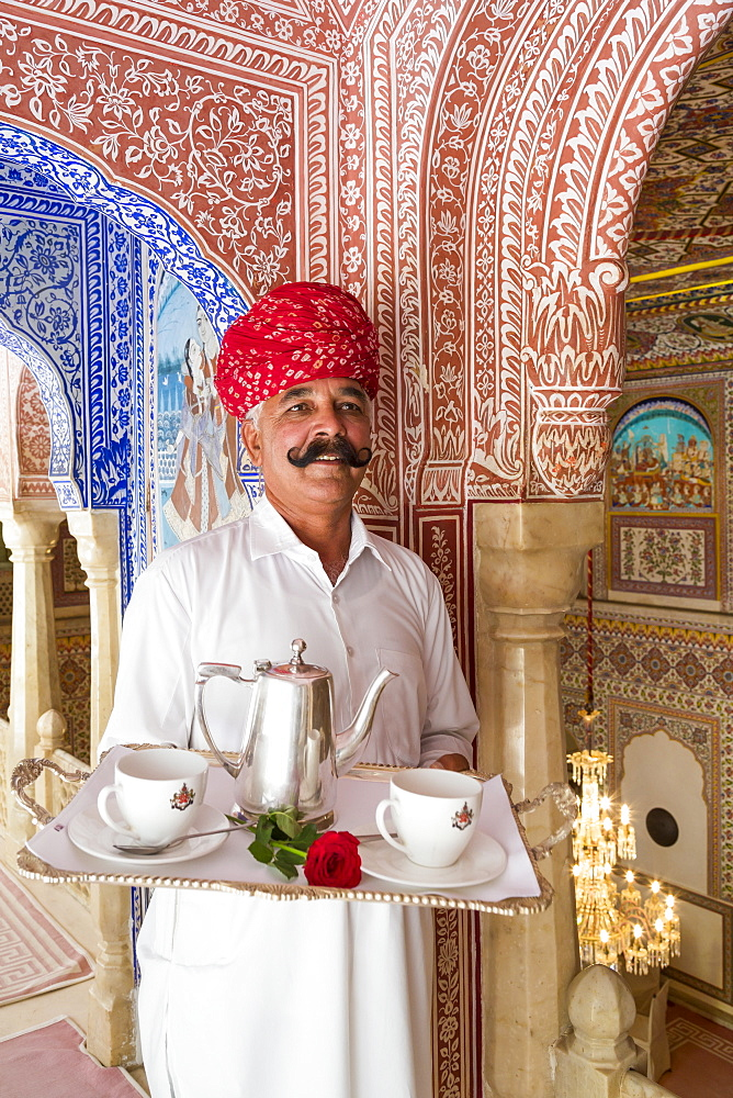 Waiter carrying tea tray in ornate passageway, Samode Palace, Jaipur, Rajasthan, India, Asia - 794-4648