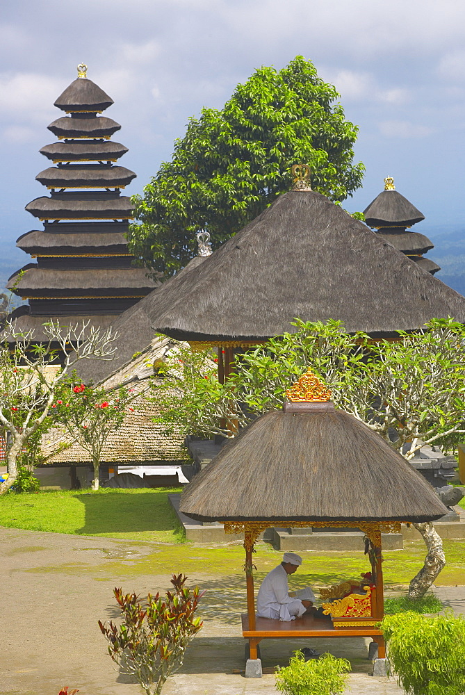 Man reading at Besakih Temple (Mother Temple), Bali, Indonesia, Southeast Asia, Asia