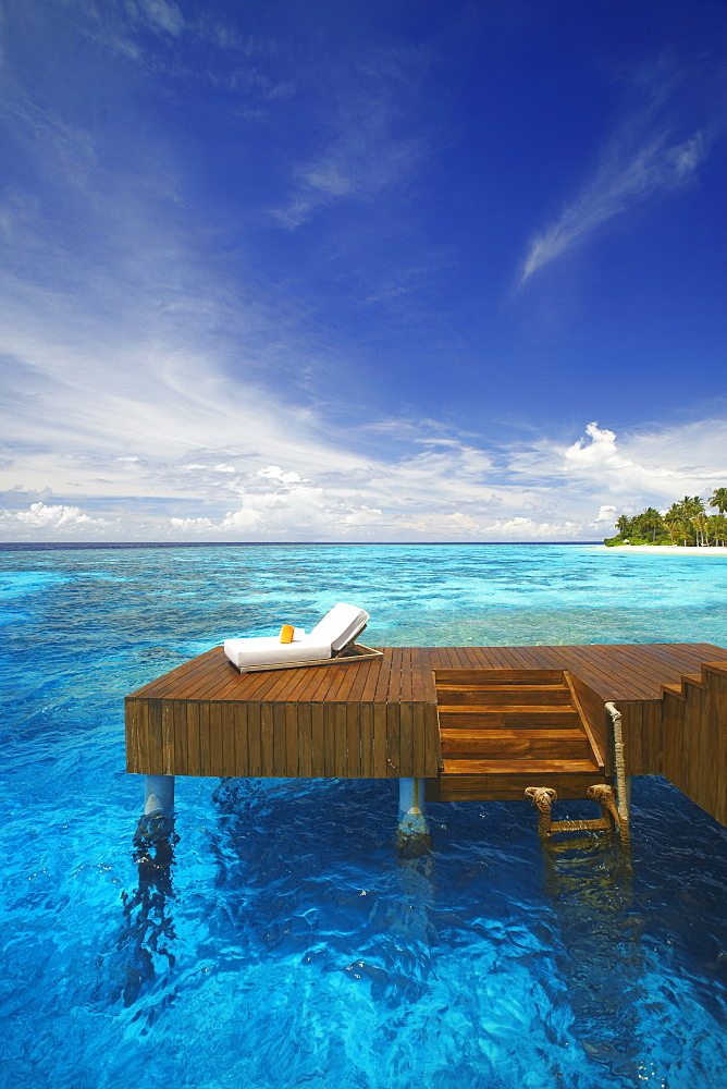 Sun lounger and jetty in blue lagoon on tropical island, Maldives, Indian Ocean, Asia - 795-365