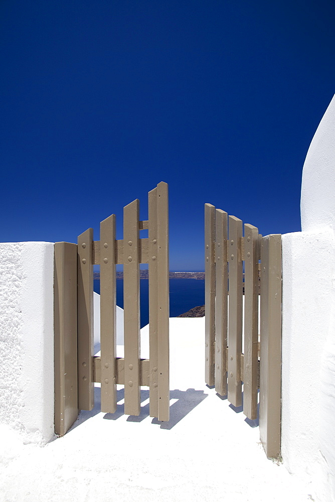 Open gate and view at Oia, Santorini, Cyclades, Greek Islands, Greece, Europe - 795-402