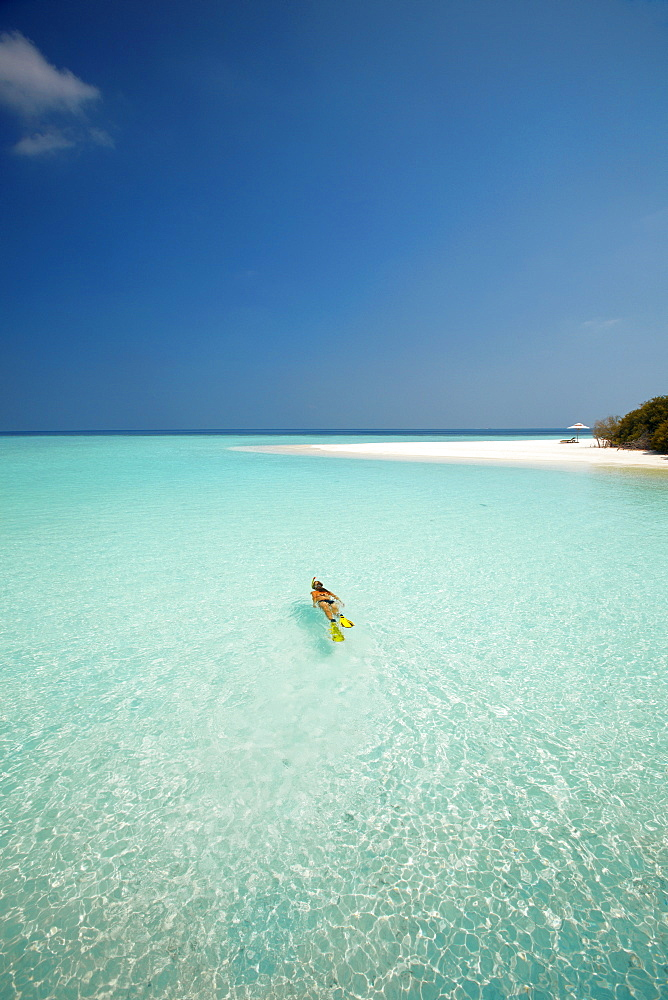 Young woman snorkelling in the Maldives, Indian Ocean, Asia