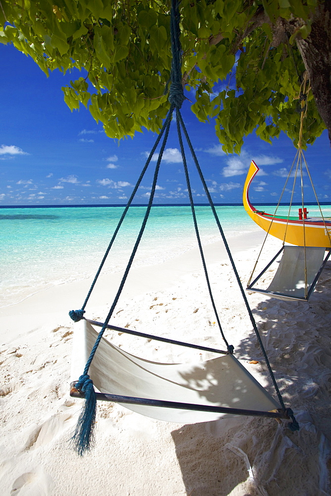 Swing and traditional boat on tropical beach, Maldives, Indian Ocean, Asia
