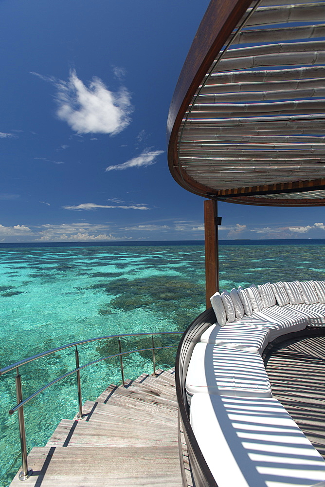 Stairs to the beach and sofa overlooking the ocean, Maldives, Indian Ocean, Asia - 795-539