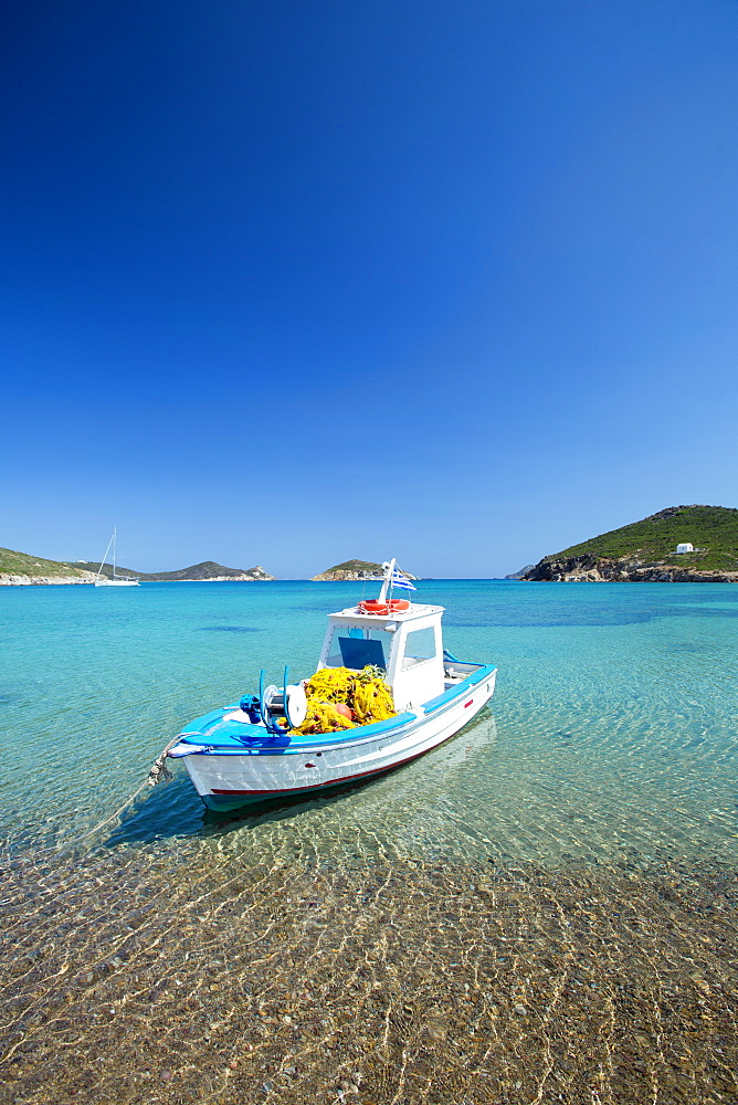 Fishing boat moored on the beach, Patmos Island, Dodecanese, Greek Islands, Greece, Europe - 795-579