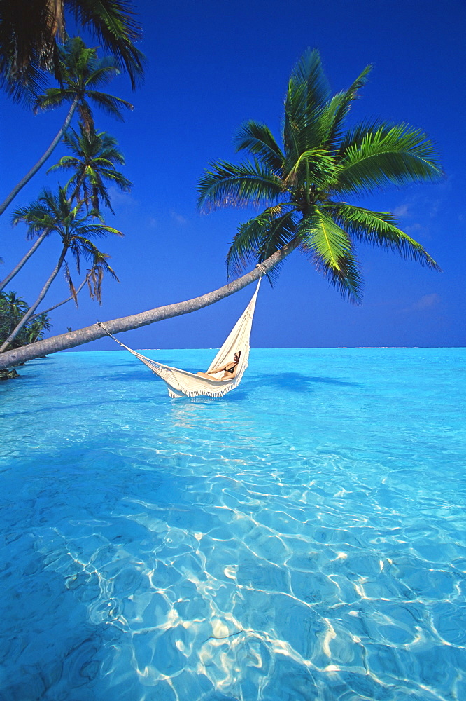 Woman in hammock, Maldives, Indian Ocean, Asia