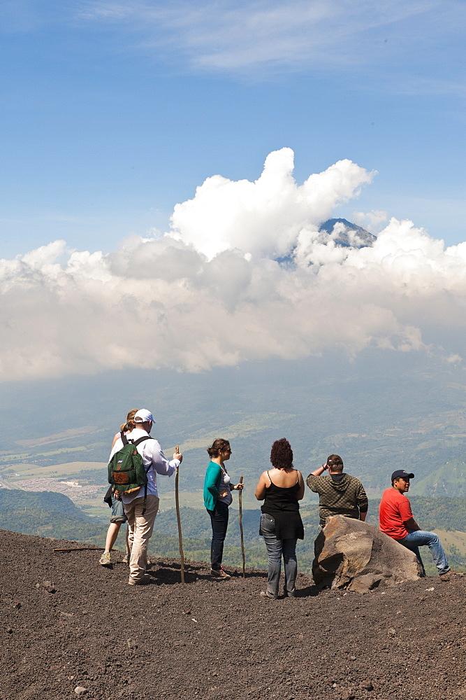 Climbing Pacaya volcano, with Fuego Volcano in distance Antigua, Guatemala, Central America