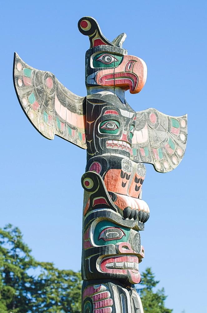 Totem poles in cemetery in Alert Bay, British Columbia, Canada, North America