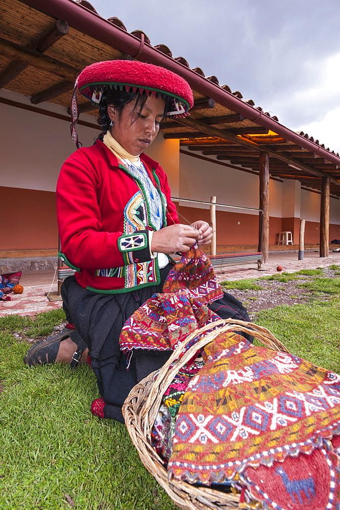 Inca woman knitting wool hat in Chinchero, Peru, South America