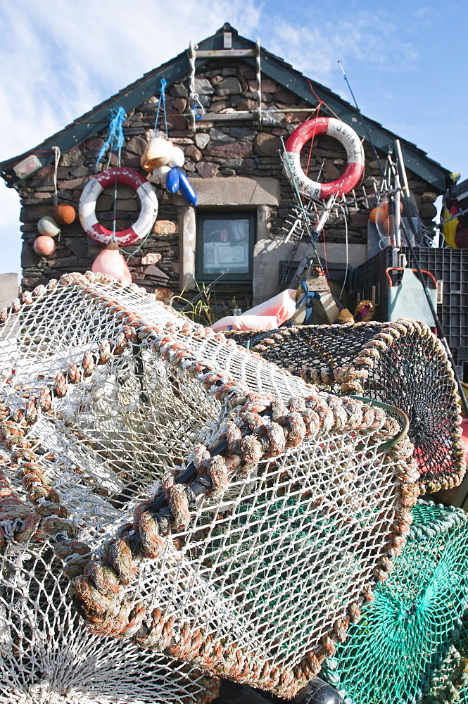 Scotland, Firth of Lorn, Isle of Easdale, Lobster pots outside a fishermans house on one the slate islands.