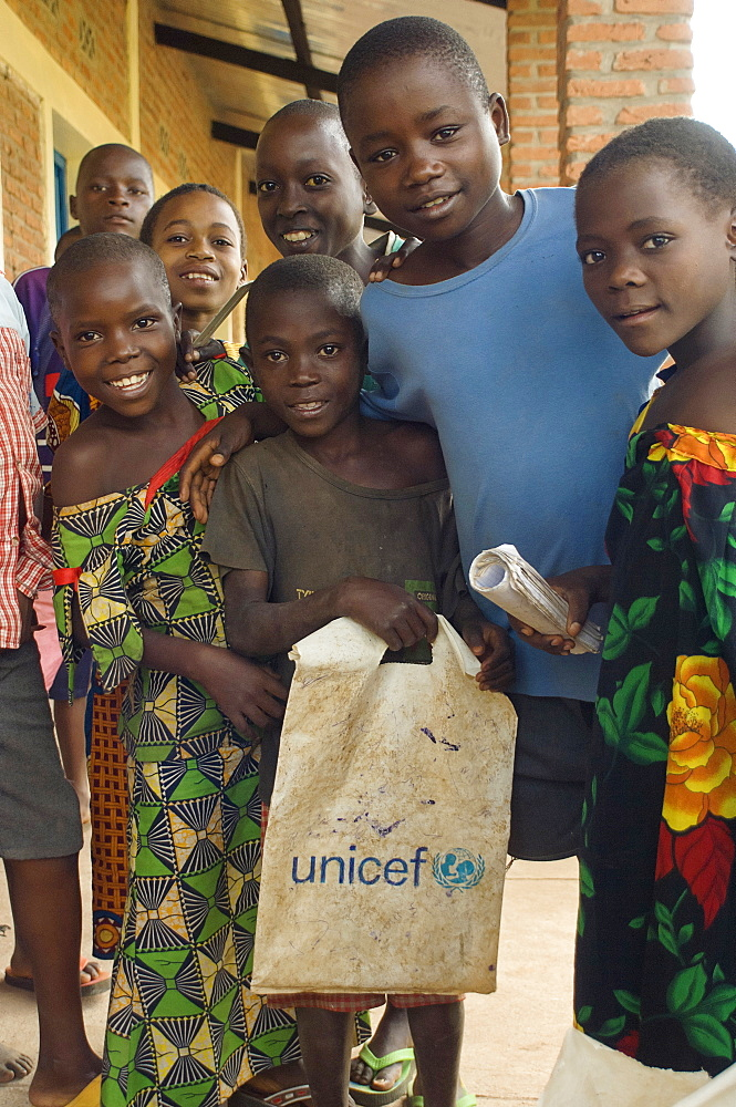 Burundi, Cibitoke Province, Buganda, School Children at a development project one holding a UNICEF carrier bag at Ruhembe Primary School.
