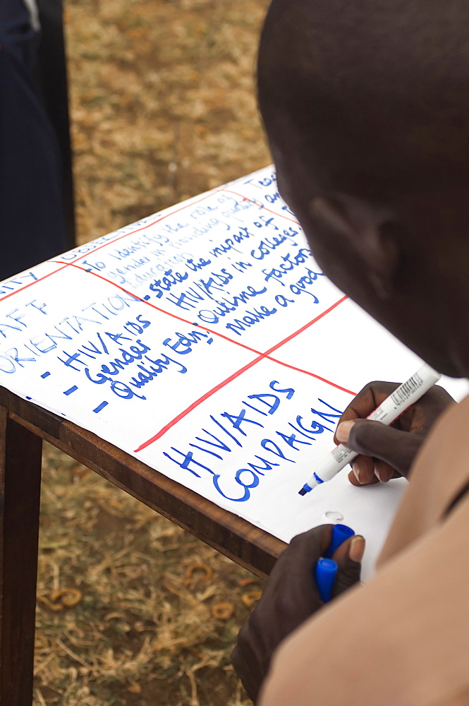Uganda, Karamoja, Teacher at a workshop to raise awareness about HIV and AIDS prevention.