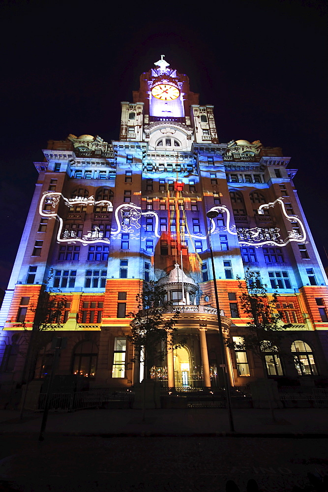 England, Merseyside, Liverpool, Royal Liver Building 100th anniversary constructed in 1911 celebrated by staging a 3D Macula light show with the theme of ship on the open seas.