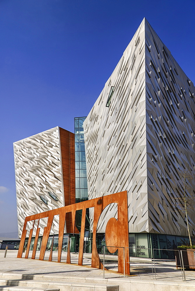 Ireland, North, Belfast, Titanic Quarter, Titanic Belfast Visitor Experience, General angular view of the building with Titanic sign outside.