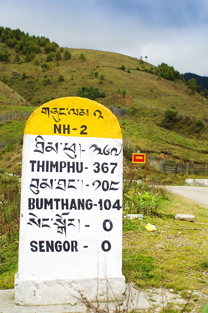 Bhutan, Sengor, Milestones on the side of the main east-west highway showing distances to towns