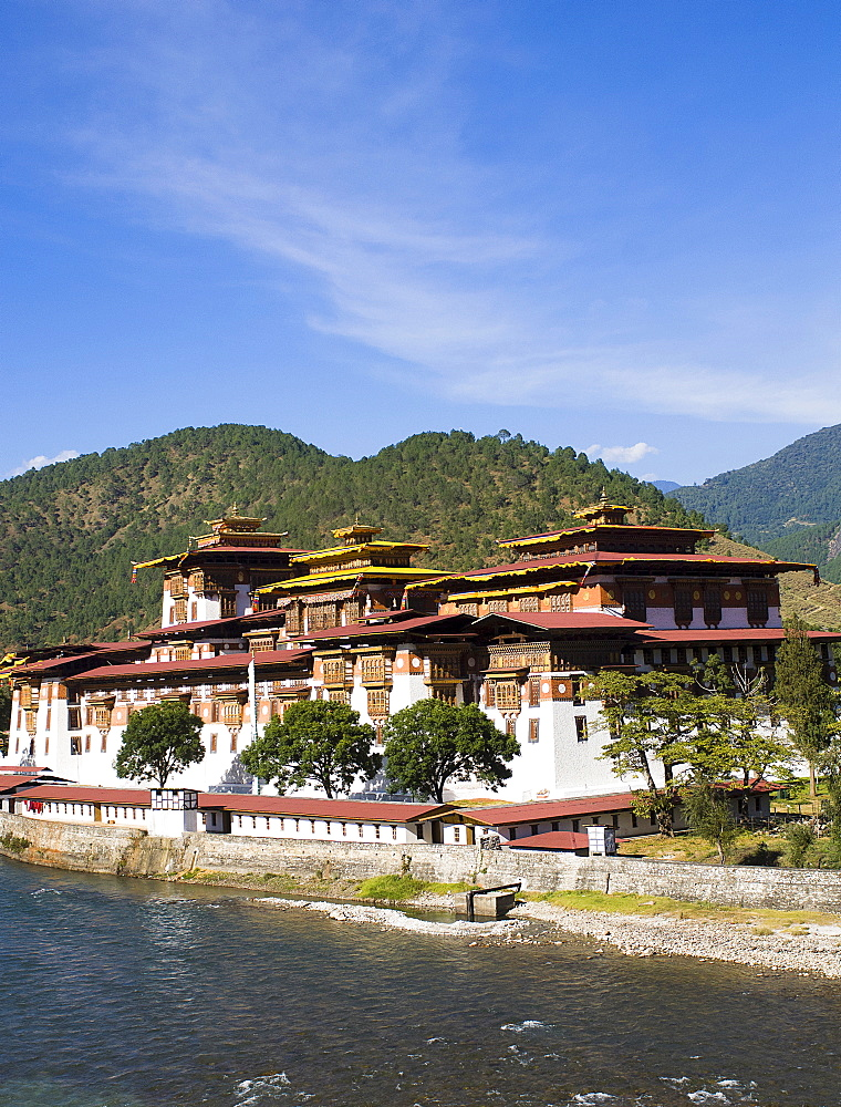 Bhutan, Punakha, Punakha Dzong, administrative centre of the region and former capital housing scared relics, beside the Mo Chhu river.