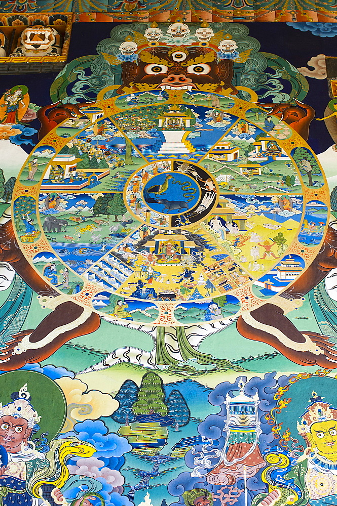 Bhutan, Punakha, Punakha Dzong, Tibetan Buddhist Wheel of Life painted on wall outside main temple.