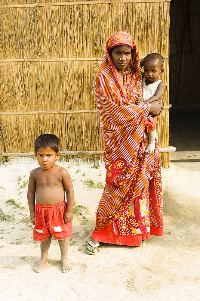 Bangladesh, Dhaka Division, Tangail Sadar Upazila, Mother and children on the impoverished chars, beside the Brahmaputra river.